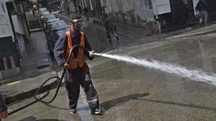 Algiers March 27 Man washing a street AFP-1