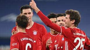 Onwards and upwards: Bayern Munich and Thomas Mueller have their eyes on the Club World Cup after Friday's clash with Hertha Berlin
