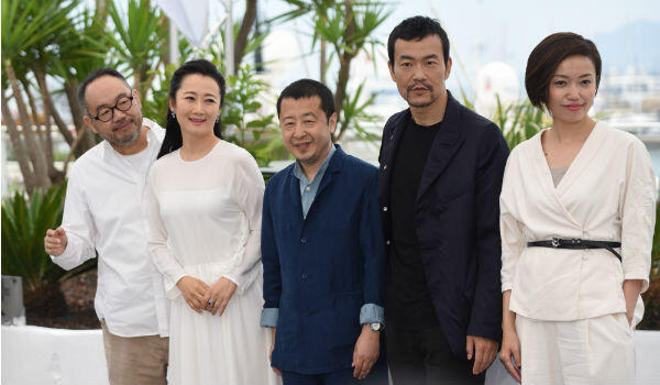 """Jia Zhangke (centre) and the cast of """"Ash Is Purest White"""" in Cannes."""