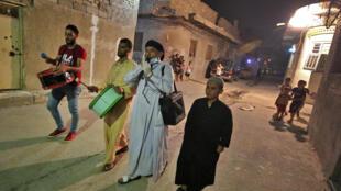 Ramadan drummers walk through a street in the Iraqi capital Baghdad