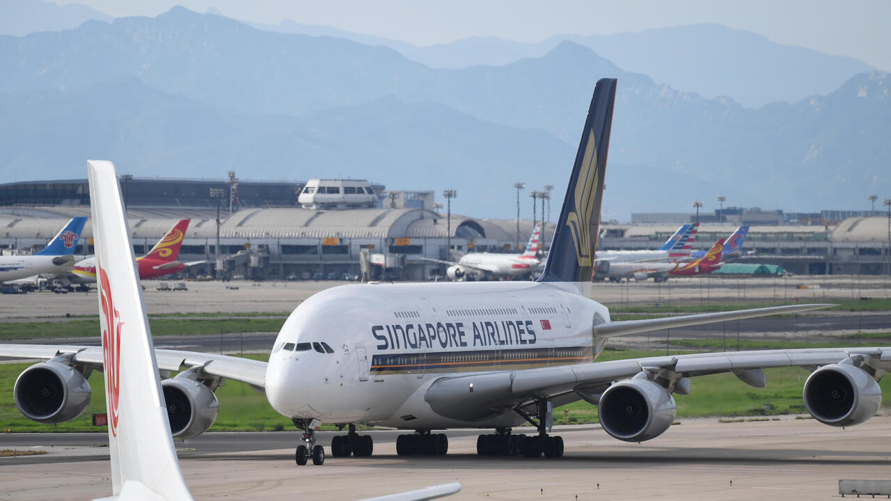 Stir-crazy 'passengers' gobble up tickets to dine on parked Singapore... image