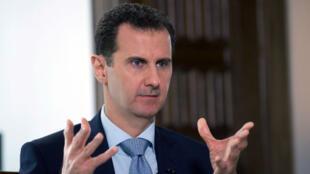"""Bachar al-Assad s'est dit confiant dans le fait que les négociations de Genève permettent de """"régler"""" la question des portefeuilles ministériels."""