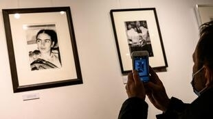 "A man looks at pictures by US artist Lucienne Bloch showing Mexican artist Frida Kahlo displayed as part of the exhibition entitled ""The artist's vision"" on February 6, 2021 in the ""Galerie de l'instant"" in Paris."