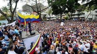 Supporters of Venezuelan opposition leader and self-proclaimed interim president Juan Guaido take part in a meeting at Chacao neighbourhood in Caracas on April 19, 2019