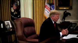 El presidente de Estados Unidos, Donald Trump, durante una videollamada con miembros del servicio militar, en la Oficina Oval la mañana de Navidad en Washington, EE. UU., El 25 de diciembre de 2018.