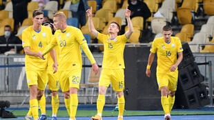 Viktor Tsygankov celebrates with teammates after scoring Ukraine's winner against Spain in the Nations League in Kiev on Tuesday