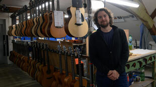 Petr Furch, son of company founder Frantisek Furch and the current chief executive of the Furch family company poses with their guitars in their production centre in Velke Nemcice, Czech Republic.