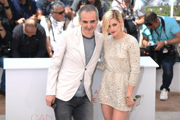 """Olivier Assayas and Kristen Stewart at the """"Personal Shopper"""" photocall in Cannes."""