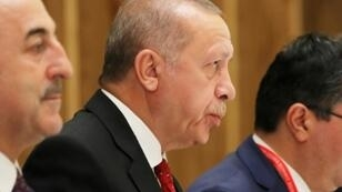 Erdogan (C) supports the internationally recognised national unity government in Tripoli