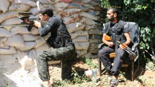 Des combattants de l'opposition modérée syrienne, le 11 septembre 2014, près d'Alep.