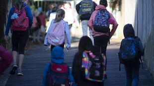 New Zealand children head to school for the first time in two moths after the coronavirus lockdown was eased