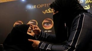 A beautician applies make-up to a Saudi woman at a bridal expo in the Red Sea city of Jeddah