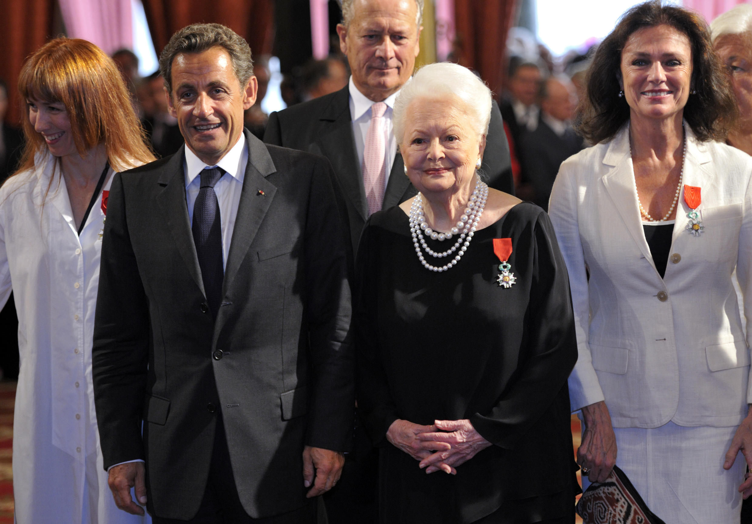 Olivia de Havilland (second from right) poses with former French president Nicolas Sarkozy and actress Jacqueline Bisset (right) after receiving the Legion of Honour in Sepetember 2010.