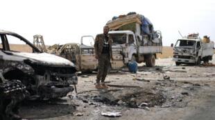 Un combatiente de la Fuerza Siria Democrática (FSD) tras un ataque en el norte de Siria