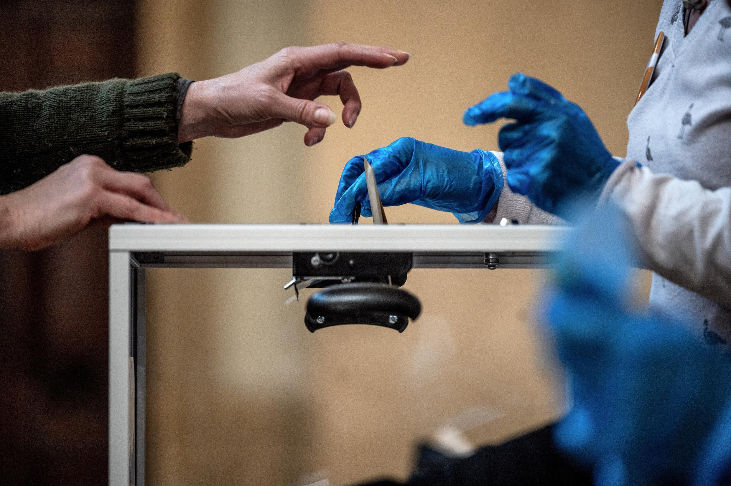 The first round of French municipal elections at a polling station in Lyon on March 15, 2020, two days before the beginning of France's Covid-19 lockdown.