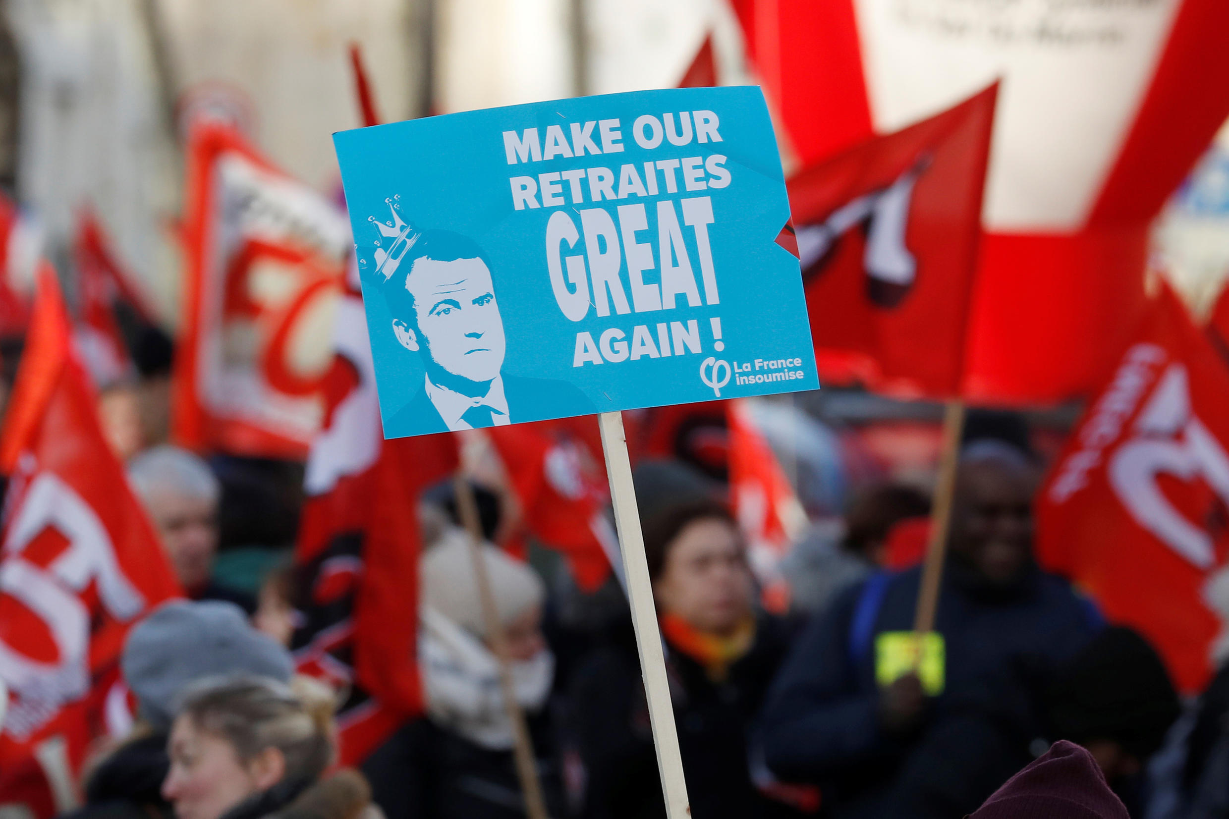 """A protest in Paris against French President Emmanuel Macron's plans to reform the country's pension system, known in France as """"retraites""""."""
