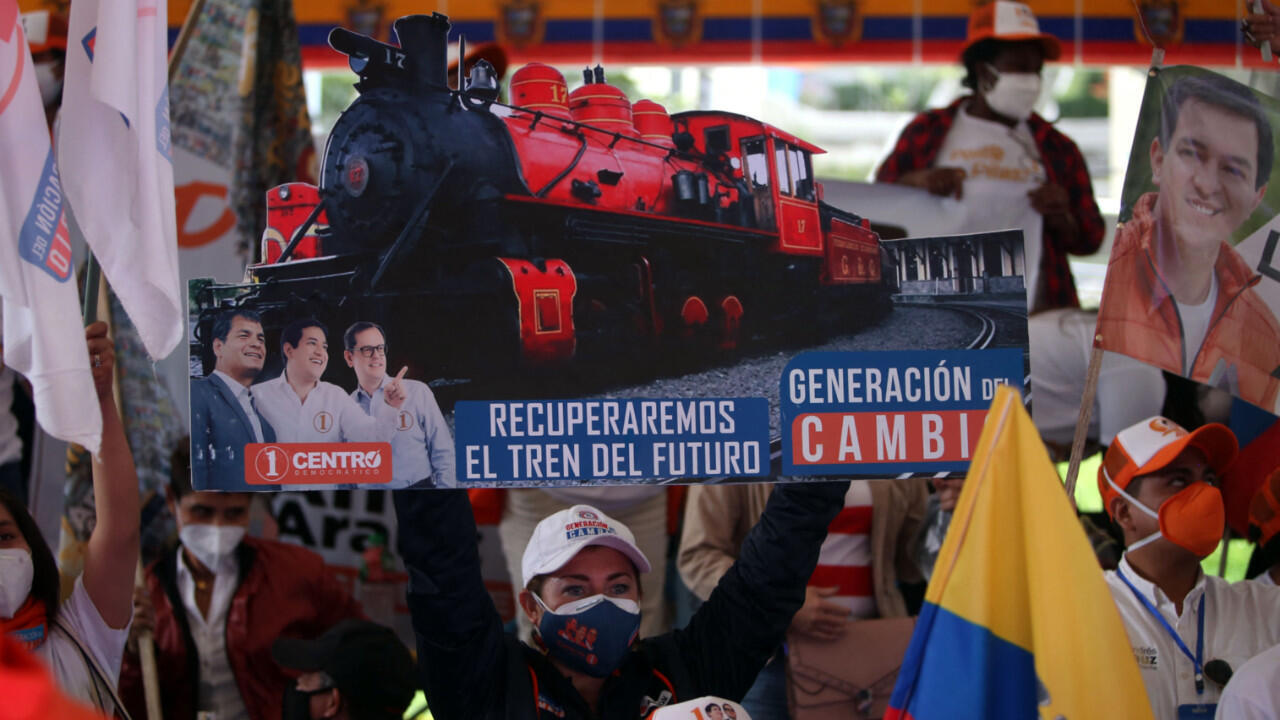"""A supporter of the Ecuadorian presidential candidate Andres Arauz holding a signal that reads """"Let's recover the train of the future"""" is seen during the closure of his electoral campaign at the Centro Cultural Deportivo Cumanda in Quito, on April 8, 2021. Leftist presidential candidate Andres Arauz will face right-wing contender Guillermo Lasso in a runoff election which will be held on Sunday, April 11."""