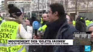 Karim Hakiki, envoyé spécial de France 24 sur les Champs-Élysées à Paris, le 8 décembre 2018