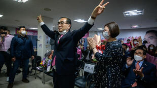 Thae Yong Ho, North Korea's highest-ranking defector, celebrates after winning a majority of votes in his Gangnam constituency on April 16, 2020.