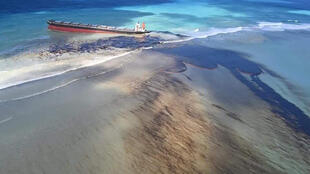 This photo taken and provided by Georges de La Tremoille of Mu Press shows oil leaking from the MV Wakashio, a bulk carrier ship that recently ran aground off the southeast coast of Mauritius, Friday, Aug. 7, 2020.