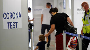 Travellers enter the new Corona Test Centre at Duesseldorf Airport in Duesseldorf, Germany, July 27, 2020.