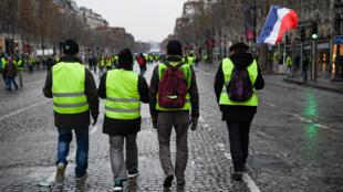 Des Gilets jaunes photographiés samedi 15 décembre à Paris (archives).