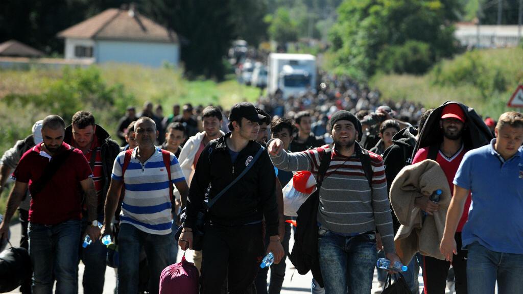 Des migrants près de la frontière entre la Croatie et la Hongrie, le 21 septembre 2015.
