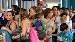 In Tumbes, on the Peruvian side of the border with Ecuador, lines of Venezuelans waited to have their papers checked