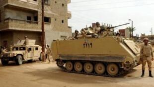 الأمن المصري يطوق موقع هجوم بعبوة ناسفة قرب حاجز للشرطة في الطالبية غرب القاهرة