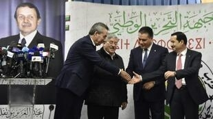 Algeria's ruling coalition principals -- (L to R) Amara Benyounes, Ahmed Ouyahia, Mouad Bouchareb, and Amar Ghoul -- shake hands after agreeing to back President Abdelaziz Bouteflika for a fifth term in Algiers on February 2, 2019