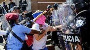 Police arrest a demonstrator in the Nicaraguan capital Managua