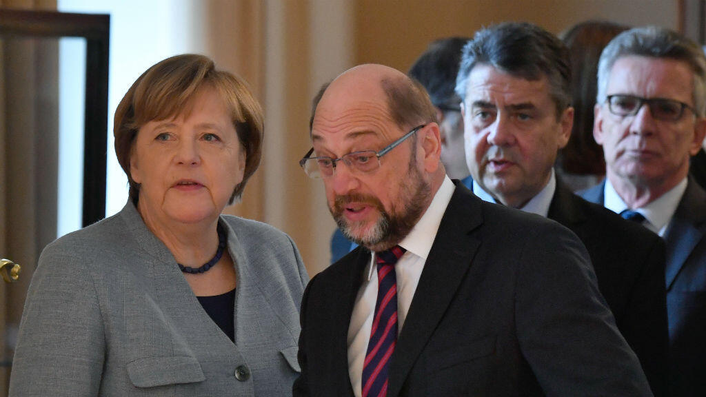 John MacDougall, AFP    German Chancellor Angela Merkel and the leader of Germany's social democratic SPD party Martin Schulz during a New Year's reception at the presidential Bellevue Palace in Berlin on January 9.