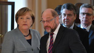 John MacDougall, AFP  | German Chancellor Angela Merkel and the leader of Germany's social democratic SPD party Martin Schulz during a New Year's reception at the presidential Bellevue Palace in Berlin on January 9.