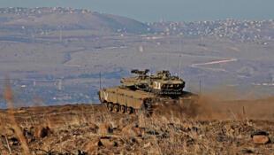 آلية عسكرية قرب الحدود السورية الإسرائيلية - أرشيف