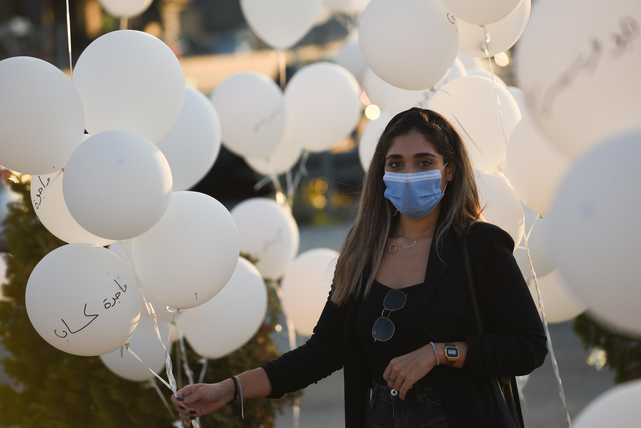 Melvine Kassab holds balloons on which she wrote the name of her mother ,Magida Kassab, who was killed during the Beirut port blast. About 200 relatives of victims released balloons at 18h07 on October 4 to mark the exact moment at which the explosion took place two months earlier.