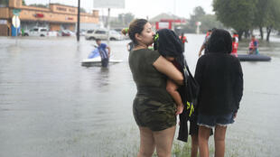 Residents survey the flooded streets of Houston as more rains are expected.