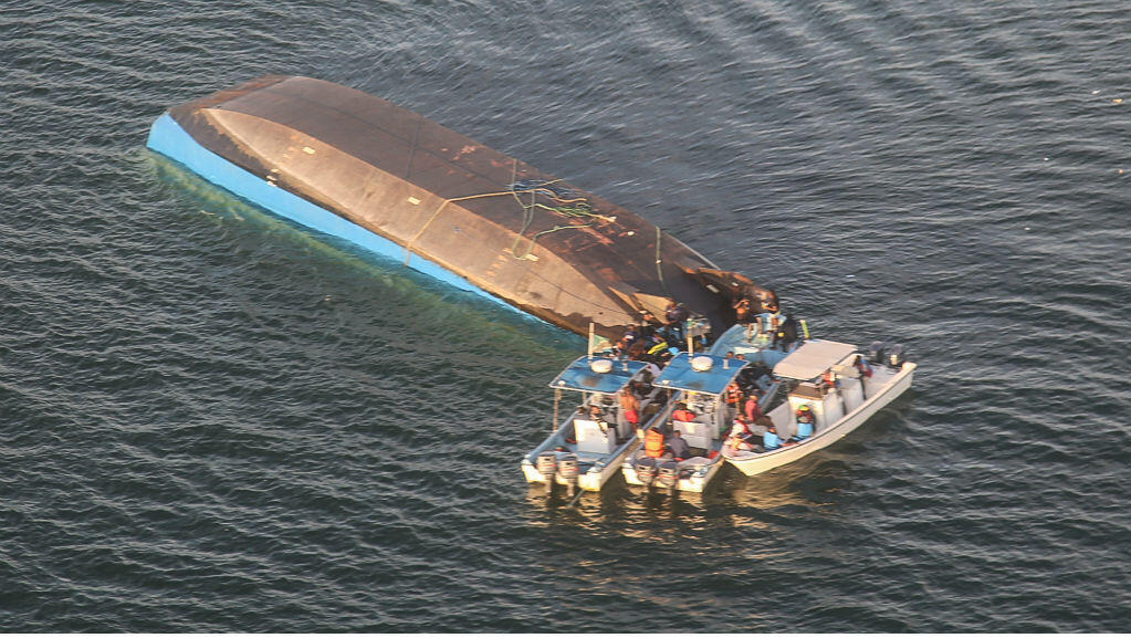 Stringer, AFP | An aerial image shows the capsized ferry MV Nyerere, which killed over a hundred people in Lake Victoria, Tanzania, on September 21, 2018.