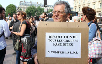 """""""Dissolve all fascist groups"""" reads a sign at Thursday's rally."""