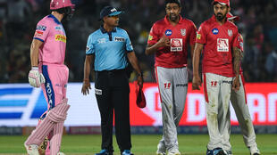 """Rajasthan Royals' Jos Buttler (left) exchanges words with Kings XI Punjab's Ravichandran Ashwin after he was run out """"Mankad"""" style by the spinner last year"""