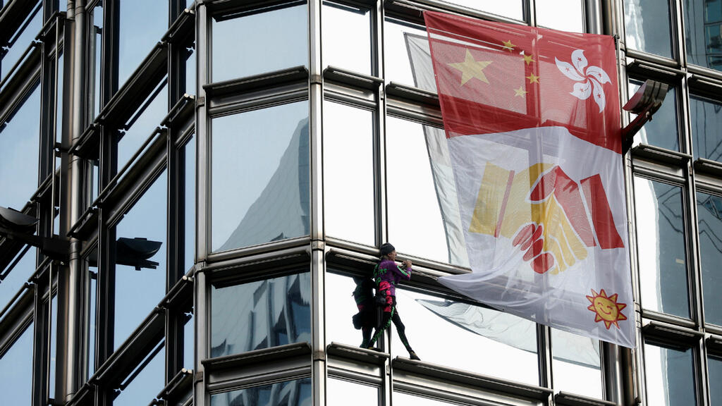 French 'Spiderman' climbs Hong Kong tower, hoists reconciliation flag