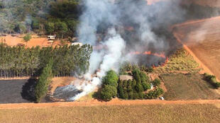 Handout picture released by the Mato Grosso State Fire Department showing an aerial view of forest fire at the Pantanal region, Mato Grosso state, Brazil