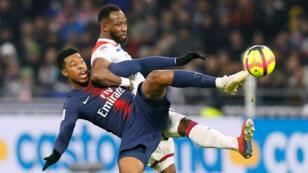 Le Lyonnais Moussa Dembélé, buteur le 3 février 2019, au duel avec le Parisien Presnel Kimpembe.