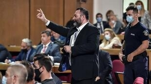 Independent Eurodeputy Ioannis Lagos (C) asked for the panel of three judges to be replaced