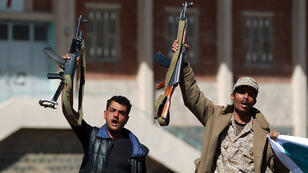 Armed Yemeni members of the Shiite Huthi movement shout slogans as they take part in a demonstration in Sanaa on February 4, 2015 in support of the militia which overran the Yemeni capital in September.