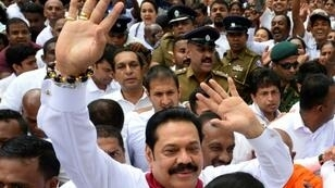 Parliament has been suspended while Rajapakse seeks support for a vote of confidence showdown by tempting defectors from other parties