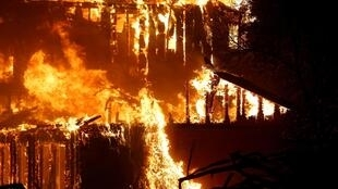 FILE PHOTO: A structure burns during the Kincade fire in Geyserville, California, U.S. October 24, 2019.