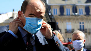 French Prime Minister Jean Castex adjusts his protective mask before taking to the media,  Nantes, France July 18, 2020.