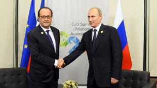 François Hollande et Vladimir Poutine lors de leur dernière rencontre lors du sommet du G20, à Brisbane le 15 novembre 2014.