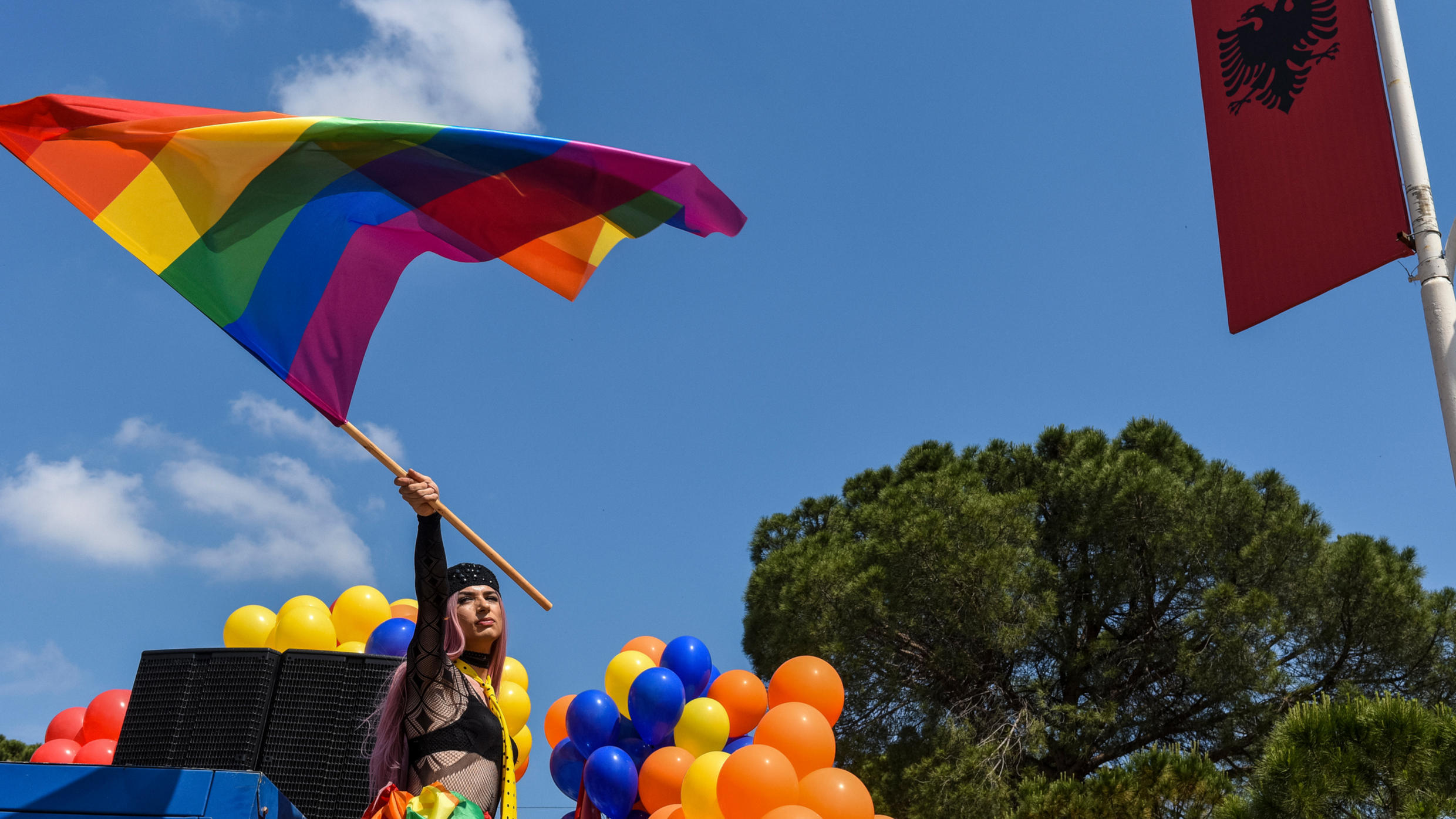 An Albanian LGBT activist waves a rainbow flag as she attends Tirana Gay Pride to mark the International Day Against Homophobia and Transphobia (IDAHOT) on the main boulevard in Tirana on May 13, 2018.