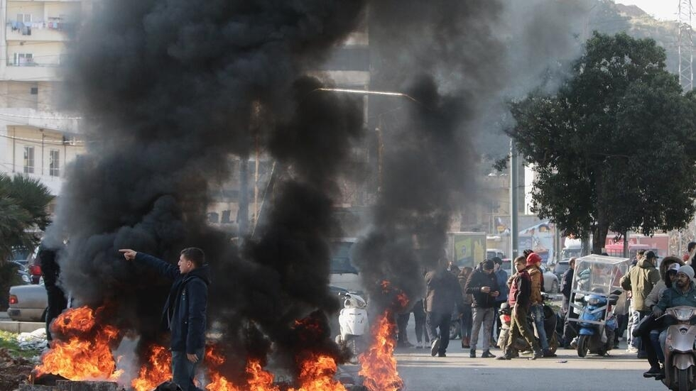 Lebanese anti-government protesters burn tires during a demonstration in the northern city of Tripoli on January 14, 2020, to denounce the political deadlock and a crippling economic crisis.